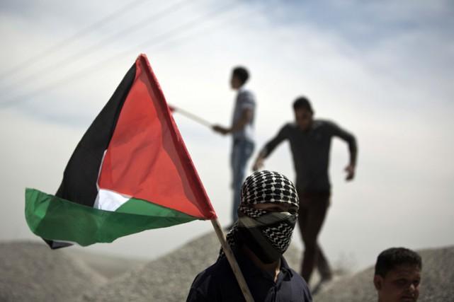 Le premier ministre israélien a soutenu, dimanche, que son pays n'était pas en... (PHOTO AFP)