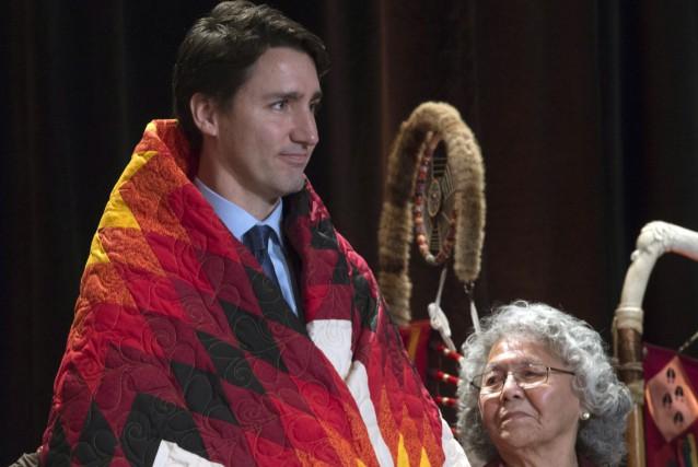 Avant de quitter la salle pour se rendre... (La Presse Canadienne, Adrian Wyld)