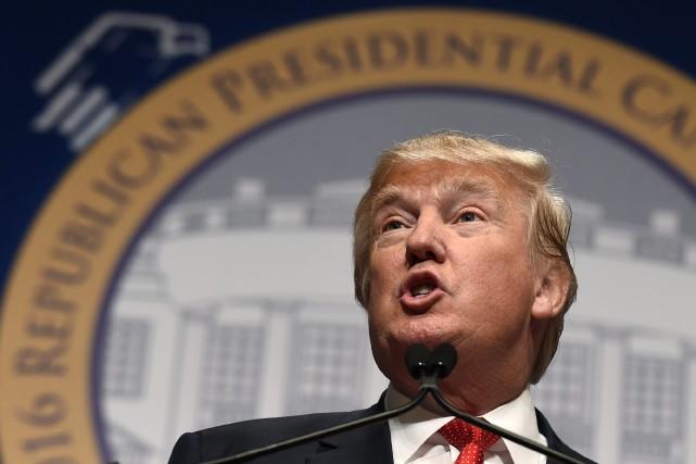 Dans un communiqué publié lundi, Donald Trump a... (AP, Susan Walsh)