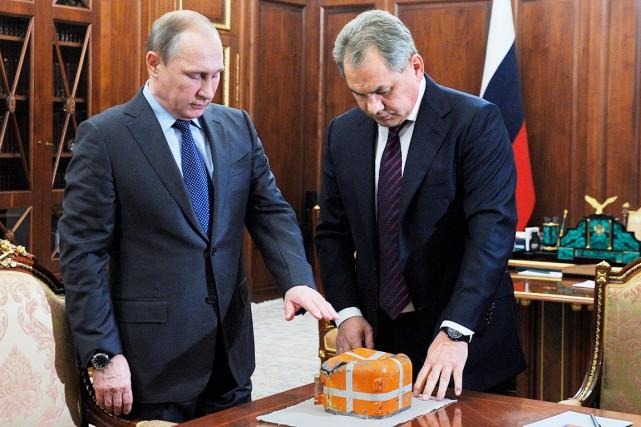 Vladimir Poutine a demandé au ministre de la... (AP, Mikhail Klimentyev)