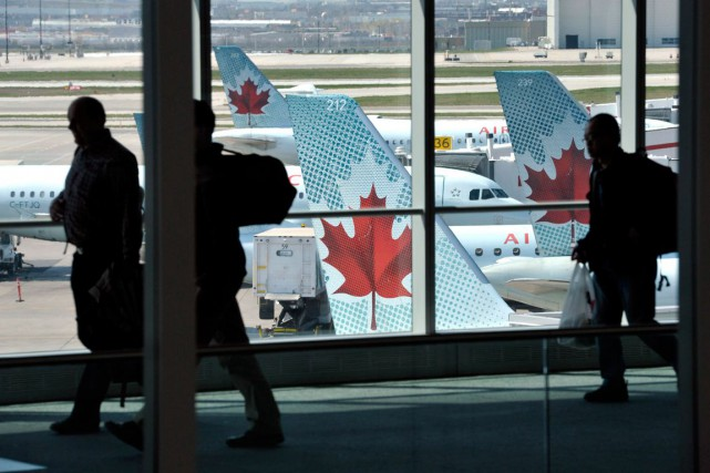 L'action d'Air Canada a atteint jeudi son plus haut niveau en plus de 10 ans,... (PHOTO MIKE CASSESE, ARCHIVES REUTERS)