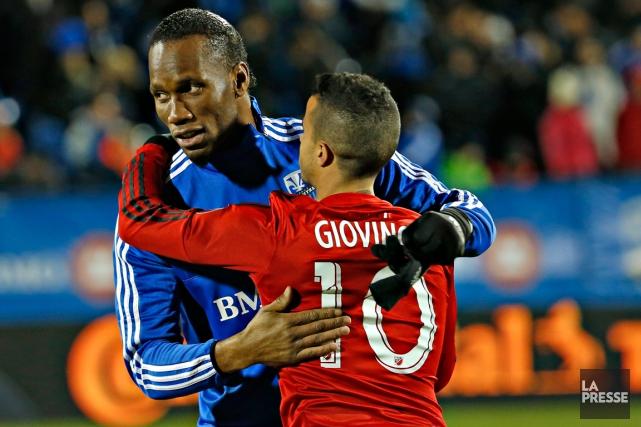 Didier Drogba, de l'Impact de Montréal, et Sebastian... (Photo Olivier Jean, archives La Presse)
