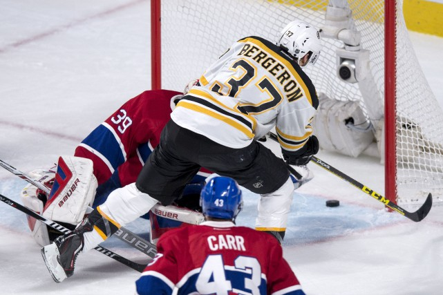 Patrice Bergeron a marqué son 576e point dans... (Paul Chiasson, PC)