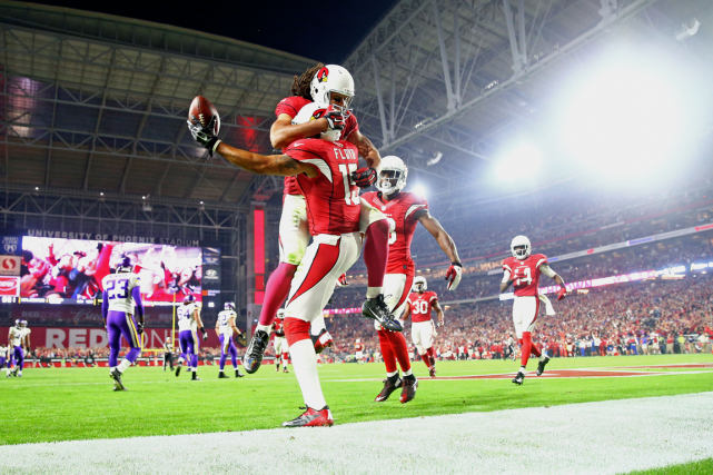 Michael Floyd (15), des Cardinals de l'Arizona, célèbre... (Photo Mark J. Rebilas, USA Today)