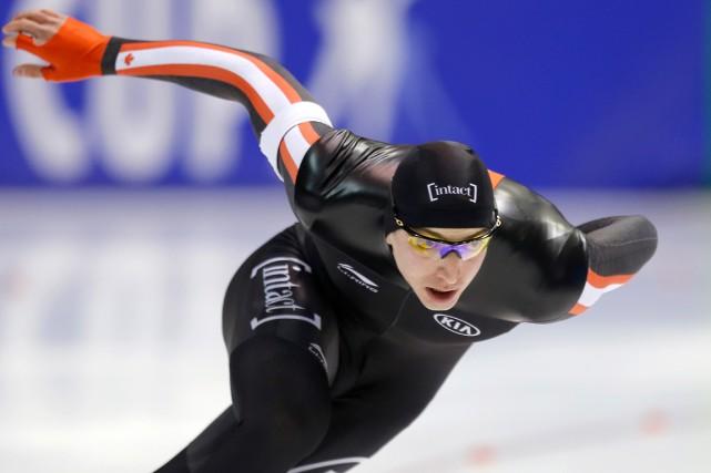 Alex Boisvert-Lacroix a ajouté une troisième médaille à... (AP, Peter Dejong)