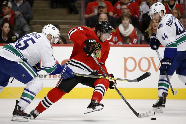 Patrick Kane a inscrit un point dans un... (Associated Press)