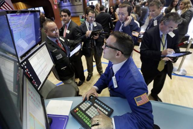 Désormais, Wall Street poursuit sa hausse «dans la... (Photo Richard Drew, AP)