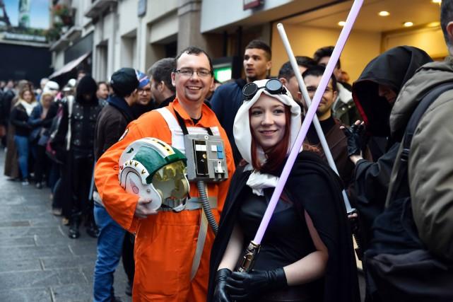 Levés aux aurores, déguisés en Jedi ou en... (PHOTO AFP)