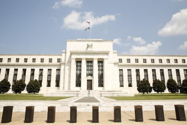 Les places financières saluaient jeudi la décision historique de la Réserve... (PHOTO ARCHIVES REUTERS)