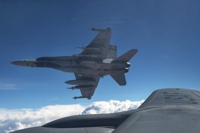 Deux CF-18 ont atteint une position de combat... (PHOTO ARCHIVES LA PRESSE CANADIENNE)