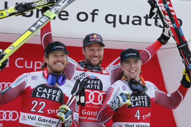 Les Norvégien Aksel Lund Svindal (au centre) a... (Photo Alessandro Trovati, AP)