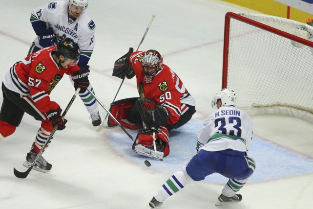Henrik Sedin a raté seulement 12 matchs au... (Photo Dennis Wierzbicki, USA TODAY Sports)