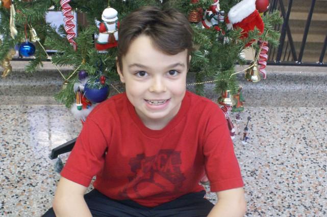 Matis Bernard, neuf ans, aime Noël parce que... (Photo Le Progrès-Dimanche, Mélissa Viau)