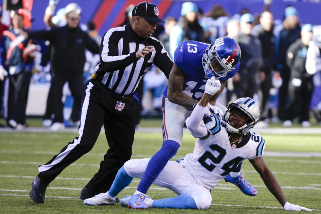 Odell Beckham (13) et Josh Norman (24) ont... (Photo Associated Press)