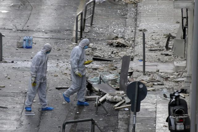 L'attentat à la bombe a endommagé l'entrée et... (PHOTO AP)