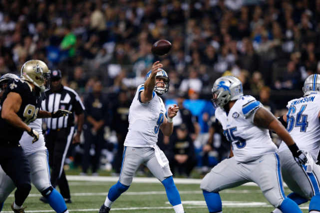 Le quart Matthew Stafford a lancé trois passes de... (Photo Brynn Anderson, AP)