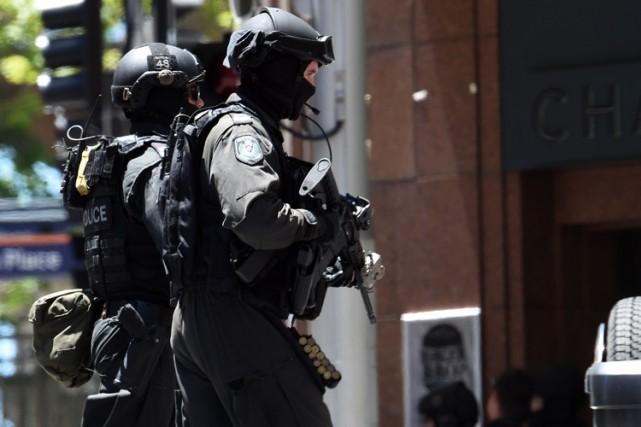 Le suspect a été interrogé à son arrivée... (PHOTO AFP)