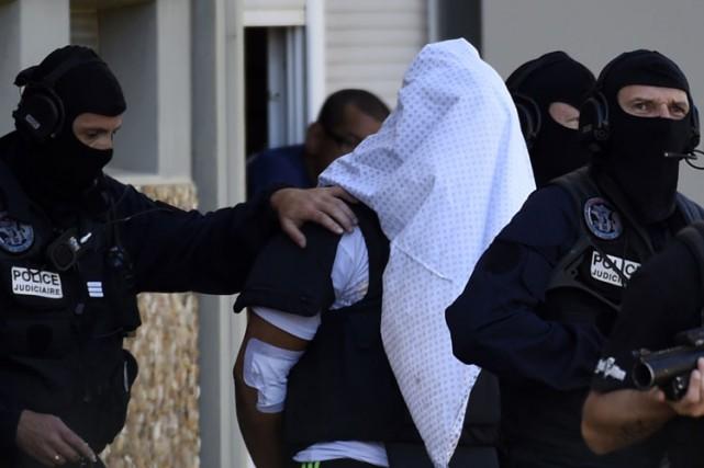 YassinSalhi, qu'on voit ici couvert d'un drap le... (PHOTO AFP)