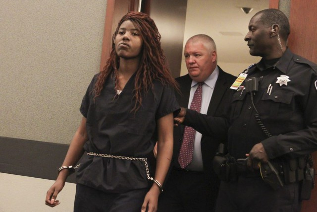 Lakeisha Nicole Holloway enters district court with one... (Chase Stevens)