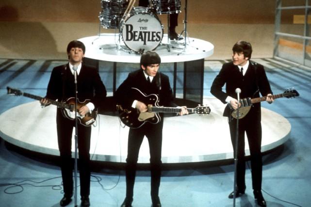 Les Beatles auEd Sullivan Showle 9 février 1964... (Archives AP)