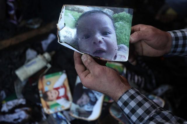 Ce bébé de 18 mois, dont un homme... (PHOTO JAAFAR ASHTIYEH, AFP)
