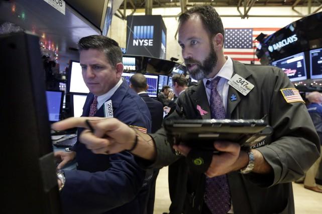 Wall Street a fini 2015 avec des résultats mitigés, la déprime des matières... (PHOTO RICHARD DREW, ASSOCIATED PRESS)