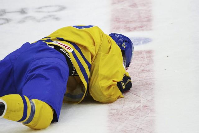 William Nylandera encaissé une violente mise en échec... (Photo Roni Rekomaa, Reuters)