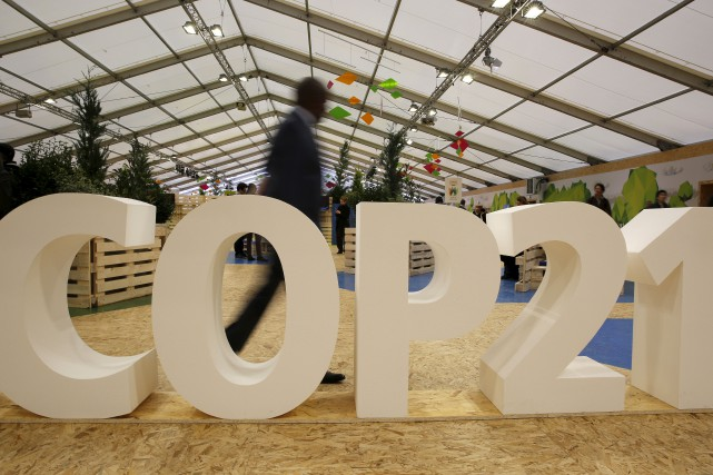 L'accord signé lors de la COP21 à Paris... (PHOTO AFP)
