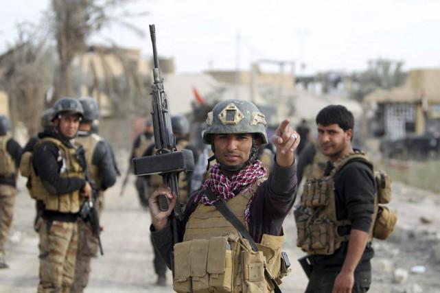 Des membres des forces d'élite irakiennes à Ramadi,... (PHOTO AHMAD AL-RUBAYE, AFP)