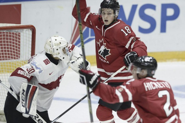 Les Suisses ont pris une avance de 2-0... (Photo Heikki Saukkomaa, Reuters)
