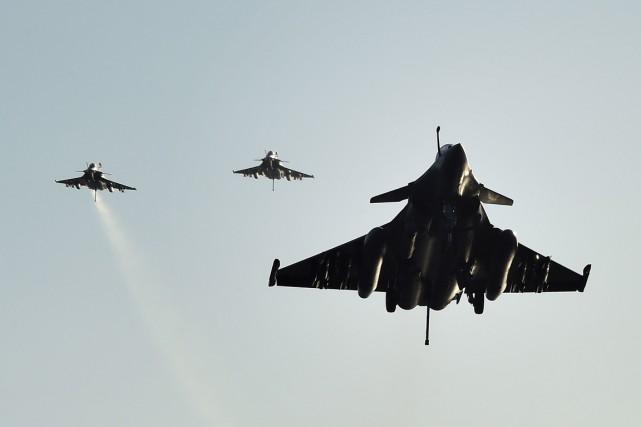 Avec 26 chasseurs Rafale et Super Etendard à... (Photo AFP)
