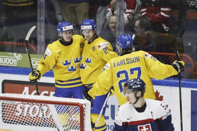 Les Suédois ont marquétrois buts en troisième période.... (PHOTO RONI REKOMAA, AFP)