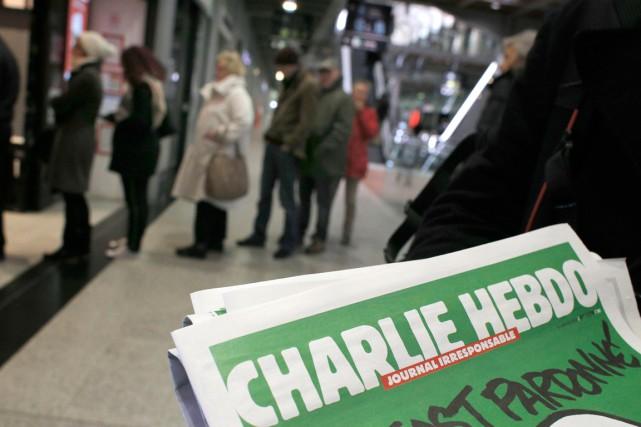 L'édition «numéro des survivants» du 14janvier s'est vendue... (PHOTO CHRISTOPHE ENA, ARCHIVES AP)