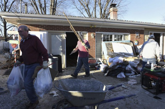 Les inondations, aggravées par plus de 25 centimètres... (Photo Kate Munsch, AFP)
