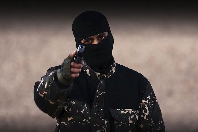 Les bourreaux accusent cinq hommes d'être des «espions»... (Agence France-Presse)