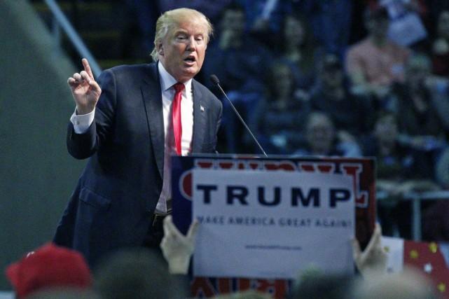 Donald Trump, qui finance lui-même sa campagne présidentielle,... (PHOTO ROGELIO V. SOLIS, ARCHIVES AP)