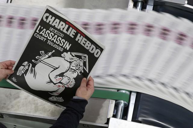 La caricature de l'hebdomadaire satirique français Charlie Hebdo... (PHOTO REUTERS)
