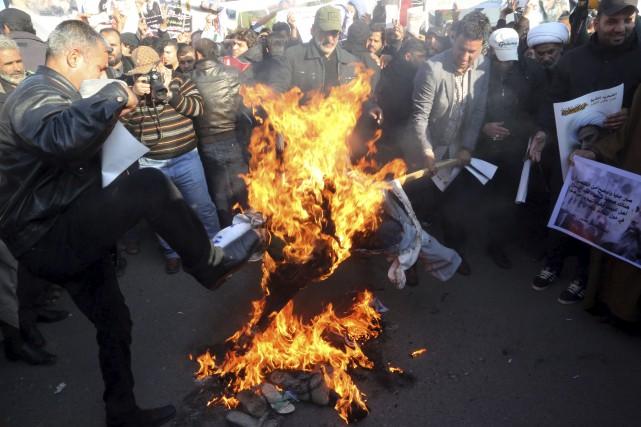 En Irak, pays à majorité chiite, la colère... (AP, Khalid Mohammed)