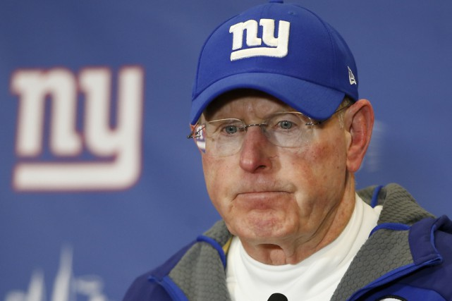 L'entraîneur-chef des Giants de New York, Tom Coughlin... (Archives Associated Press)