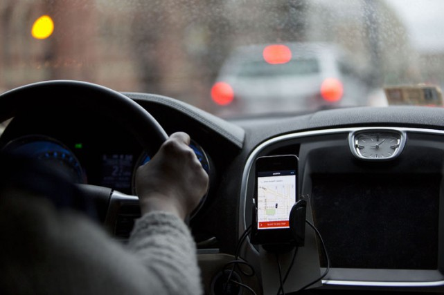 La concurrence directe d'UberX aux services de taxis... (PHOTO ARCHIVES BLOOMBERG)