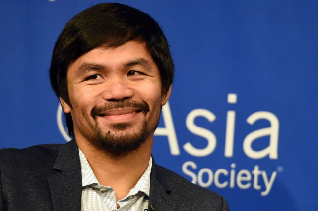 Manny Pacquiao... (PHOTO ARCHIVES AFP)