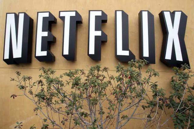 Netflix continue d'attirer de nouveaux abonnés et de se distinguer dans les... (Photo archives AP)
