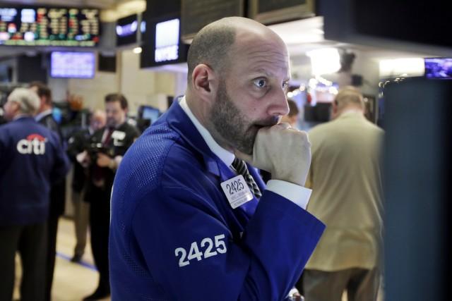 Pour la deuxième fois cette semaine, les Bourses... (AP, Richard Drew)