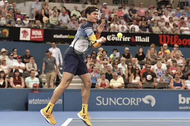 Milos Raonic lors du match contre Lucas Pouille,... (Photo SAEED KHAN, AFP)