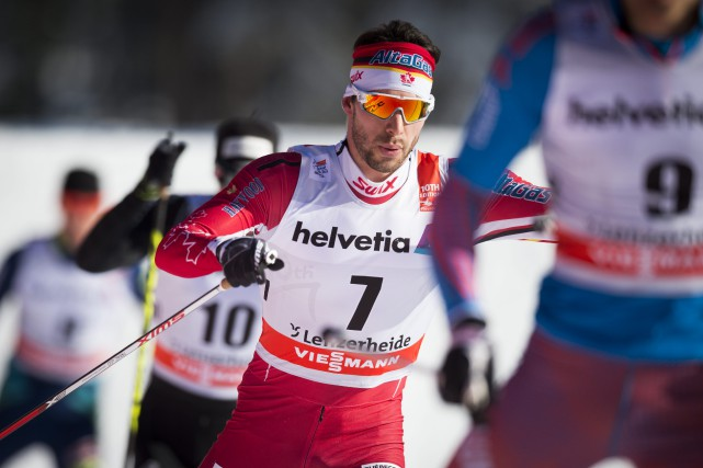 Alex Harvey a terminé septième au 15 km... (AP, Gian Ehrenzeller)