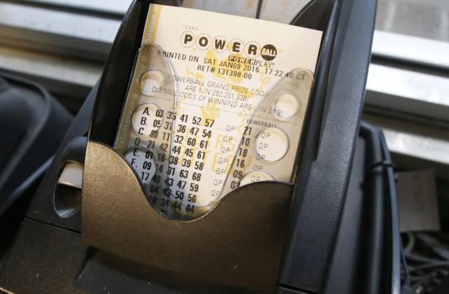 Le gros lot de cette loterie a grimpé... (PHOTO LM OTERO, AP)