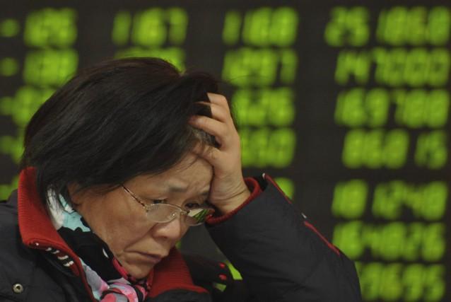 L'indice composite shanghaïen a chuté en clôture de... (Photo AP)