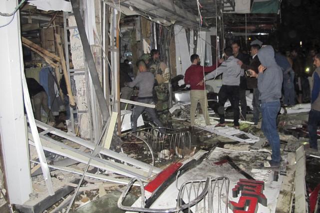 La première attaque a visé en fin d'après-midi... (AFP, Sabah Arar)