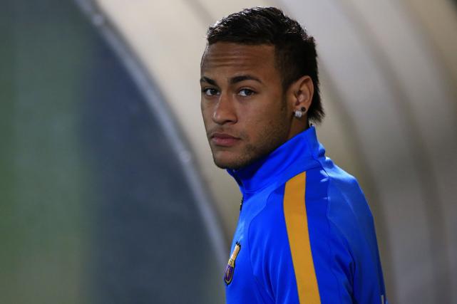 Un tribunal espagnol a ordonné au footballeur Neymar... (Photo Pau Barrena, AFP)