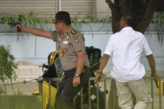 Au moins quatre personnes ont été tuées dans des explosions causées par des... (Photo AFP)